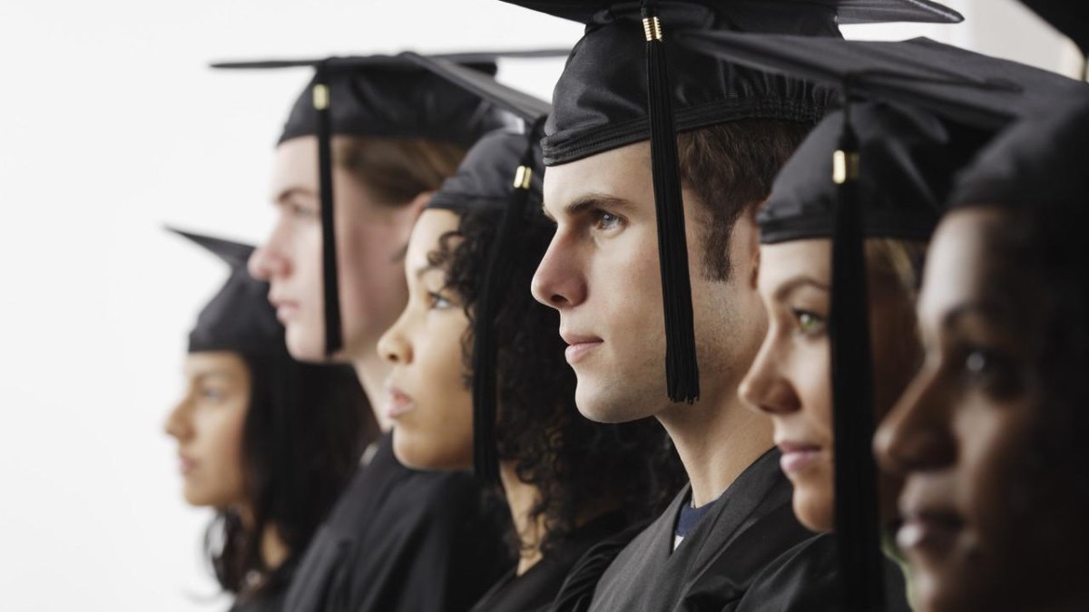 Graduates in Cap and Gown --- Image by © Royalty-Free/Corbis