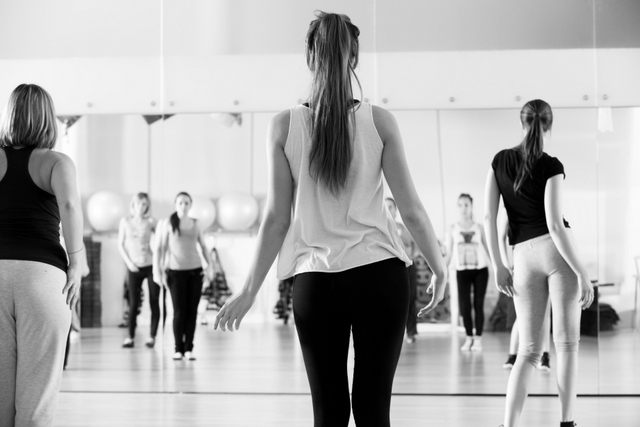 Dance class for women at fitness centre black and white